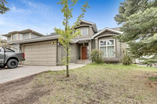 Photo 1: 1518 Evergreen Drive SW in Calgary: Evergreen Detached for sale : MLS®# A1110638