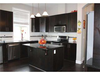 """Photo 8: 1319 SOBALL Street in Coquitlam: Burke Mountain House for sale in """"BURKE MOUNTAIN HEIGHTS"""" : MLS®# V1024016"""