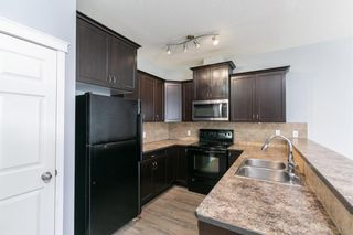 Photo 7: 58 Arbours Circle NW: Langdon Row/Townhouse for sale : MLS®# A1137898