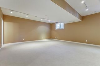 Photo 20: 45 PROMINENCE Park SW in Calgary: Patterson Semi Detached for sale : MLS®# C4249195