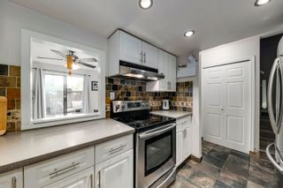 """Photo 9: 916 BRITTON Drive in Port Moody: North Shore Pt Moody Townhouse for sale in """"Woodside Village"""" : MLS®# R2616930"""