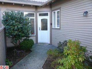 "Photo 1: # 4 14909 32ND AV in Surrey: King George Corridor Condo for sale in ""Ponderosa Station"" (South Surrey White Rock)  : MLS®# F1112168"