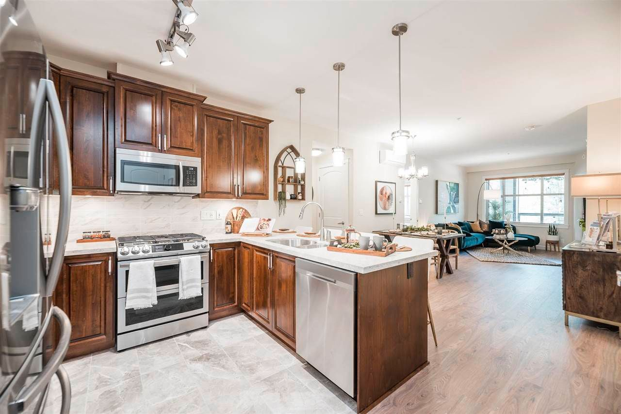 Main Photo: 302 20290 86 Avenue in Langley: Willoughby Heights Condo for sale : MLS®# R2583608