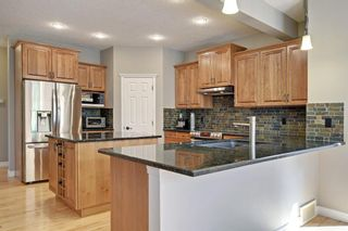 Photo 9: 145 TREMBLANT Place SW in Calgary: Springbank Hill Detached for sale : MLS®# A1024099