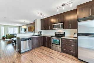 Photo 8: 1562 93 Street SW in Calgary: Aspen Woods Row/Townhouse for sale : MLS®# A1085332