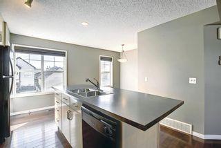 Photo 9: 3326 New Brighton Gardens SE in Calgary: New Brighton Row/Townhouse for sale : MLS®# A1077615