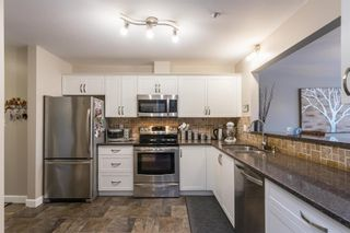 """Photo 4: 107 5909 177B Street in Surrey: Cloverdale BC Condo for sale in """"Carridge Court"""" (Cloverdale)  : MLS®# R2602969"""