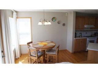 Photo 10: 100 TUSCANY RAVINE Road NW in Calgary: Tuscany House for sale : MLS®# C4030985