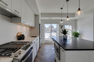 Photo 7: 205 3605 16 Street SW in Calgary: Altadore Row/Townhouse for sale : MLS®# A1102720