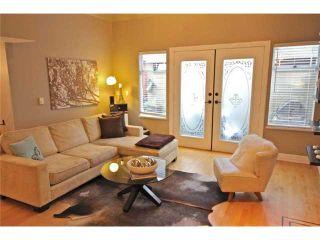 Photo 2: 2054 W 13TH AV in Vancouver: Kitsilano Condo for sale (Vancouver West)  : MLS®# V1037624
