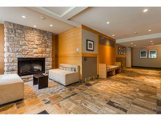 "Photo 2: 415 600 KLAHANIE Drive in Port Moody: Port Moody Centre Condo for sale in ""BOARDWALK"" : MLS®# R2531989"