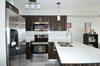"""Photo 2: 308 22318 LOUGHEED Highway in Maple Ridge: West Central Condo for sale in """"223 NORTH"""" : MLS®# R2447386"""