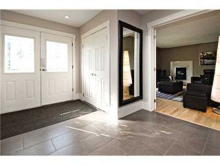 Photo 2: 3216 LANCASTER Way SW in Calgary: Lakeview House for sale : MLS®# C3654257