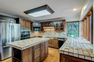 Photo 13: 331 Coach Light Bay SW in Calgary: Coach Hill Detached for sale : MLS®# A1132031