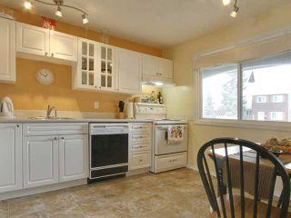 Photo 3: 333 Georgian Villas NE in Calgary: Marlborough Park House for sale : MLS®# C3468386
