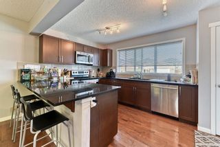 Photo 12: 203 River Heights Green: Cochrane Detached for sale : MLS®# A1145200
