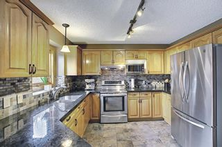 Photo 9: 212 Edgebrook Court NW in Calgary: Edgemont Detached for sale : MLS®# A1105175