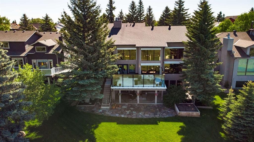 Mature trees accentuate the privacy of this beautiful home