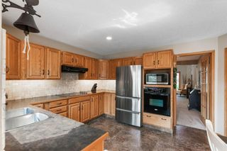 Photo 13: 75 Silverstone Road NW in Calgary: Silver Springs Detached for sale : MLS®# A1129915