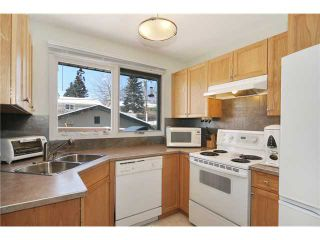 Photo 5: 712 Hunterplain Hill NW in Calgary: Huntington Hills Residential Detached Single Family for sale : MLS®# C3467636