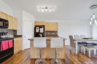Photo 6: 204 11 PANATELLA Landing NW in Calgary: Panorama Hills Row/Townhouse for sale : MLS®# A1109912