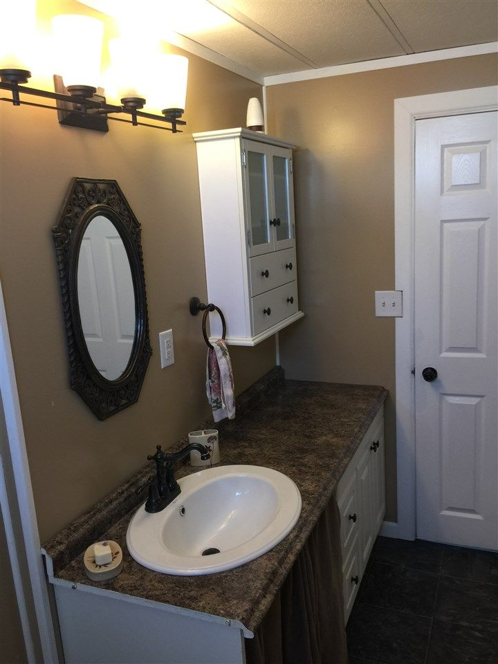 """Photo 16: Photos: 41 8420 ALASKA Road in Fort St. John: Fort St. John - City SE Manufactured Home for sale in """"PEACE COUNTRY MOBILE HOME PARK"""" (Fort St. John (Zone 60))  : MLS®# R2069792"""