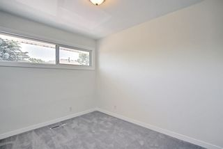 Photo 12: 272 Regal Park NE in Calgary: Renfrew Row/Townhouse for sale : MLS®# A1125307
