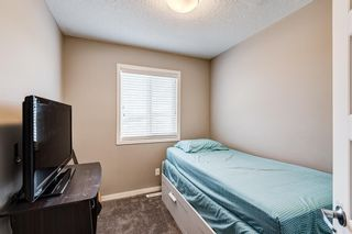 Photo 21: 504 Panatella Walk NW in Calgary: Panorama Hills Row/Townhouse for sale : MLS®# A1153133