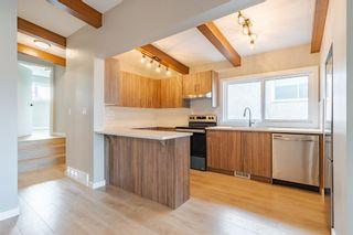 Main Photo: 713 67 Avenue SW in Calgary: Kingsland Semi Detached for sale : MLS®# A1148863