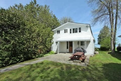 Main Photo: 76 Lakeside Dr, Innisfil, Ontario L9S2V3 in Innisfil: Detached for sale (Rural Innisfil)  : MLS®# N2869905