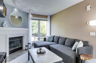 Photo 3: 81 Coachway Gardens SW in Calgary: Coach Hill Row/Townhouse for sale : MLS®# A1147900