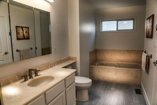 Photo 12: 258 NEWDALE Court in North Vancouver: Upper Delbrook House for sale : MLS®# R2596261