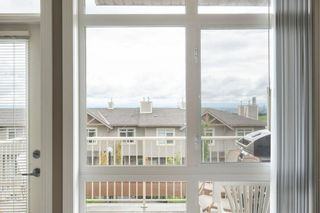 Photo 11: 9 140 Rockyledge View NW in Calgary: Rocky Ridge Row/Townhouse for sale : MLS®# A1118889