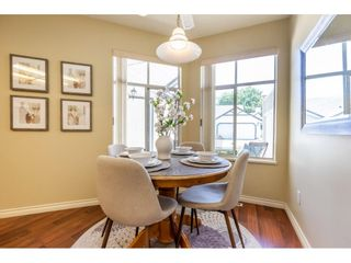 """Photo 16: 106 19649 53 Avenue in Langley: Langley City Townhouse for sale in """"Huntsfield Green"""" : MLS®# R2595915"""