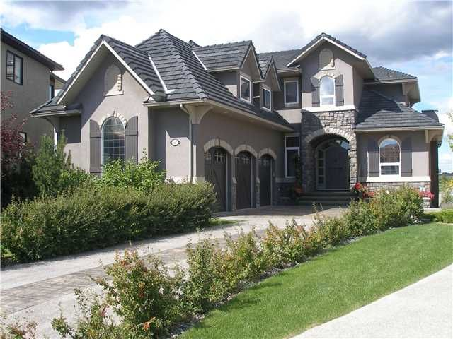 Large executive Custom built home backing onto Fish Creek Park.  Triple car garage, rubber roof and very impressive architerial design detailing.  This home is a walk-out pie lot and is a must see.