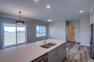 Photo 7: 1401 19489 Main Street SE in Calgary: Seton Apartment for sale : MLS®# A1136338