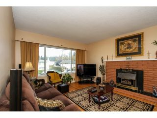 """Photo 2: 2070 FOSTER Avenue in Coquitlam: Central Coquitlam House for sale in """"CENTRAL COQUITLAM"""" : MLS®# V1110577"""