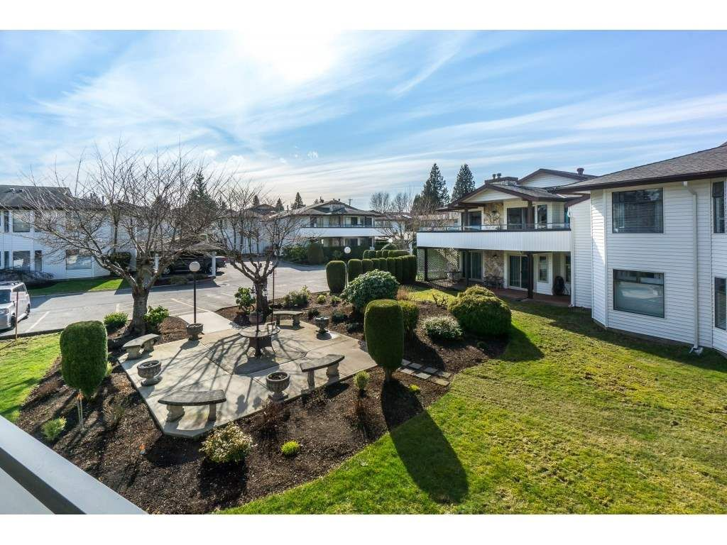 """Main Photo: 220 15153 98 Avenue in Surrey: Guildford Townhouse for sale in """"Glenwood Villiage"""" (North Surrey)  : MLS®# R2246707"""