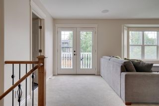 Photo 14: 212 Somme Avenue SW in Calgary: Garrison Woods Row/Townhouse for sale : MLS®# A1129738