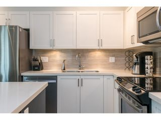 """Photo 12: 106 6655 192 Street in Surrey: Clayton Townhouse for sale in """"ONE 92"""" (Cloverdale)  : MLS®# R2492692"""
