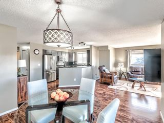 Photo 2: 2414 60 Panatella Street NW in Calgary: Panorama Hills Apartment for sale : MLS®# A1098316