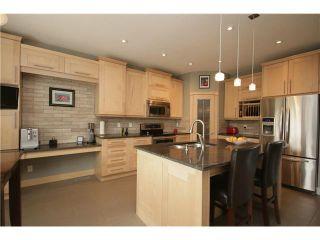 Photo 5: 224 SUNTERRA RIDGE Place: Cochrane Residential Detached Single Family for sale : MLS®# C3633482