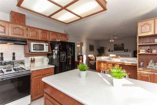 "Photo 11: 15720 95 Avenue in Surrey: Fleetwood Tynehead House for sale in ""Bel-Air Estates"" : MLS®# R2359980"