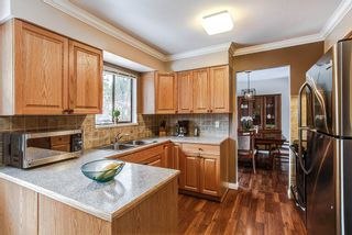 Photo 2: 3271 NORFOLK Street in Port Coquitlam: Lincoln Park PQ House for sale : MLS®# R2139122
