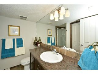 Photo 40: 14 WEST POINTE Manor: Cochrane House for sale : MLS®# C4108329