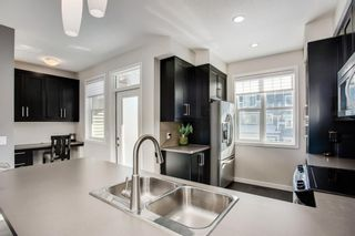 Photo 8: 25 Nolan Hill Boulevard NW in Calgary: Nolan Hill Row/Townhouse for sale : MLS®# A1073850