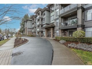 """Photo 3: 401 33338 MAYFAIR Avenue in Abbotsford: Central Abbotsford Condo for sale in """"THE STERLING"""" : MLS®# R2617623"""
