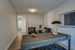 Photo 12: 501 128 Waterfront Court SW in Calgary: Chinatown Apartment for sale : MLS®# A1107113