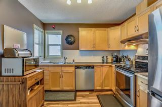 Photo 7: 25 200 HIDDEN HILLS Terrace in Calgary: Hidden Valley Row/Townhouse for sale : MLS®# A1022696