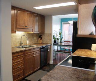Photo 4: 12 LORELEI Close in Edmonton: Zone 27 Townhouse for sale : MLS®# E4224877